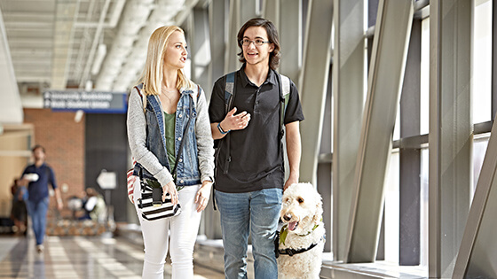 Student walking with support animal
