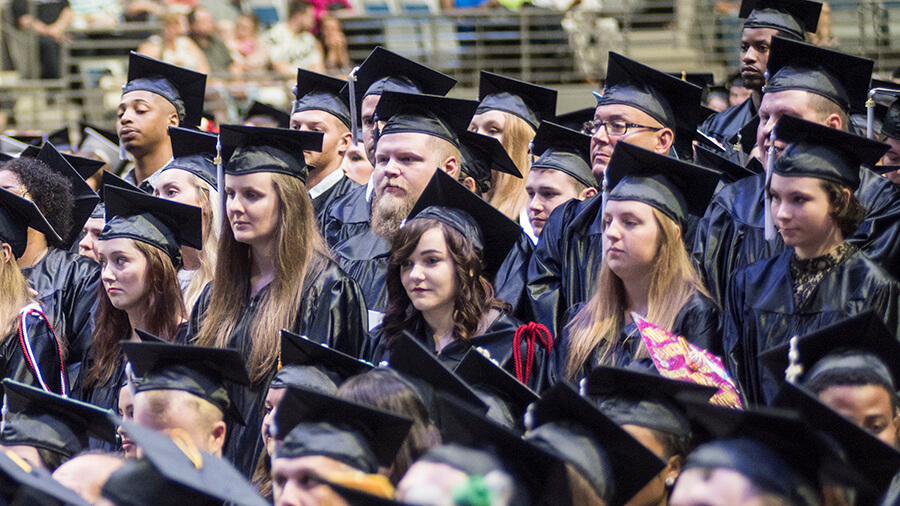 A crowd of students are lined up during commencement.