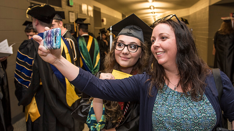 A student and her guest partaking in a selfie