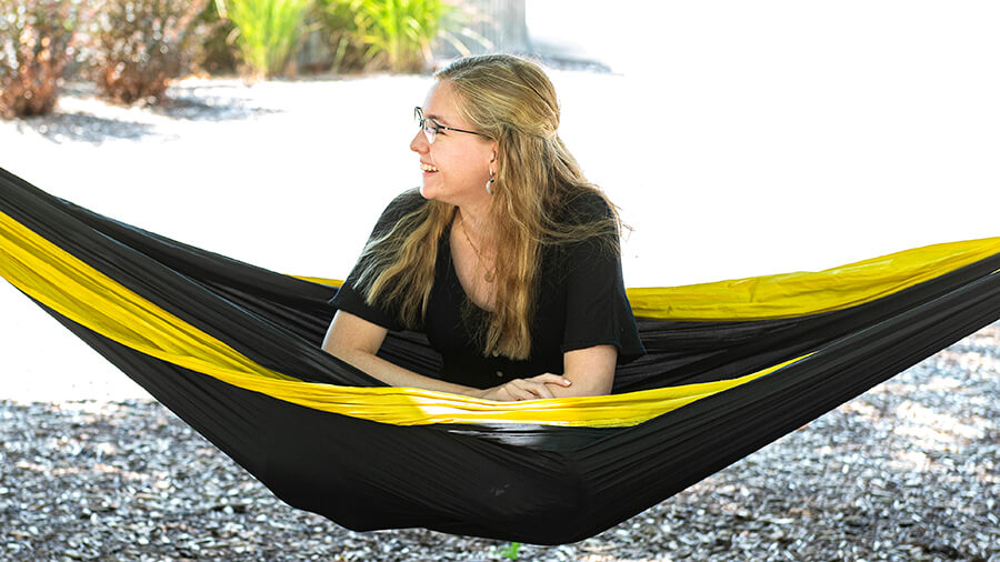 A student hangs out in a hammock on the Purdue Fort Wayne campus.