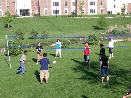 Students playing volleyball at IPFW housing