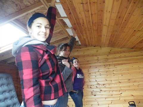 Some of our girls are putting up a roof at Eagle Creek.
