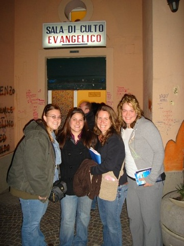 Team members pose outside of an evangelical church in Naples