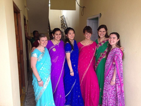 Students and Melissa showing off their saris