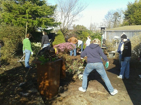 The team is busy at work cleaning up the back yard of ReachFar
