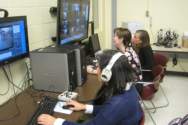 Photo of counseling students using video technology to improve their counseling skills.
