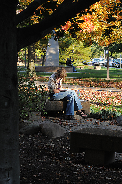 Student studying outside of Kettler Hall