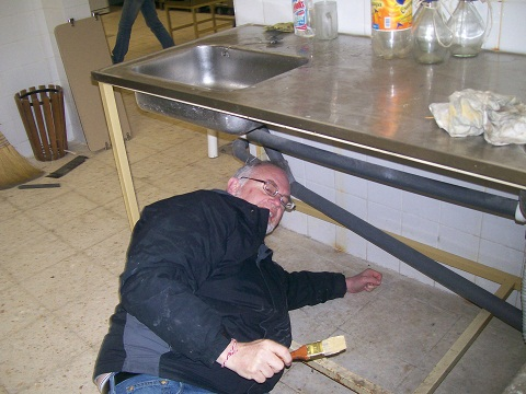 Campus Minister Ben Gates does some painting in a food kitchen in Sofia