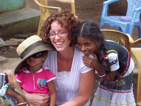 Team member Sarah cuddles with the children of Pastor Prasad and his family