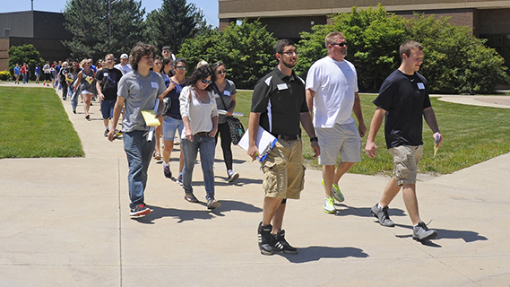 A group of students take a tour around campus.
