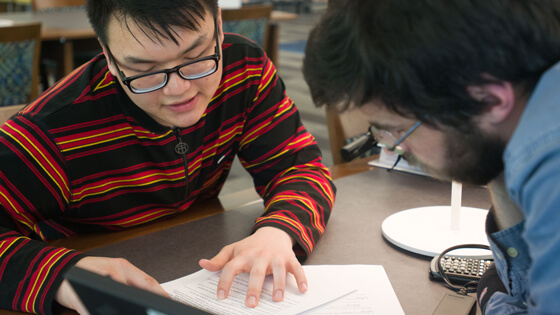 A student gets help from a tutor.