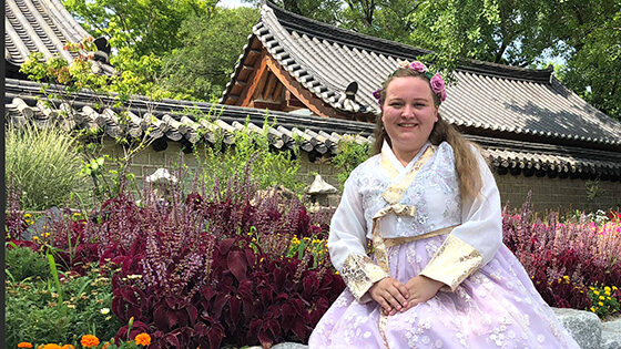 A student poses in traditional Japanese clothes.