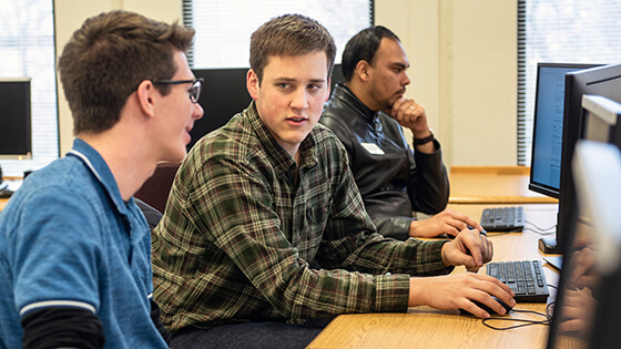 Students discuss their schedules and register for classes through the student portal.