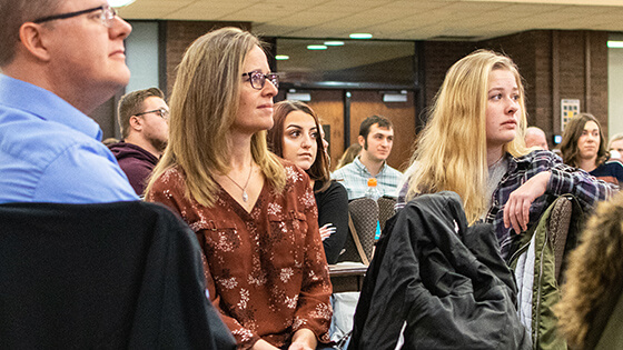 Students listen to a presentation during New Student Orientation.