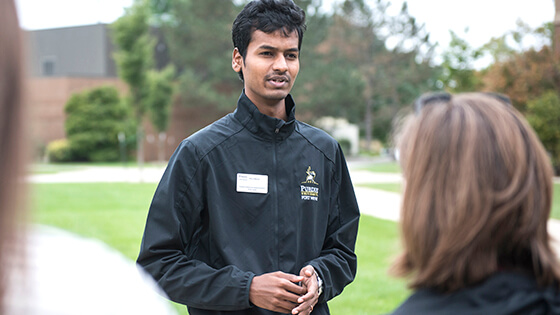 A student leads a tour around campus.