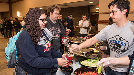 Students being served free food at homecoming event
