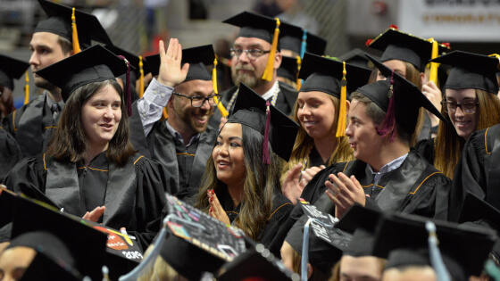 Purdue Fort Wayne students smiling while at Commencement