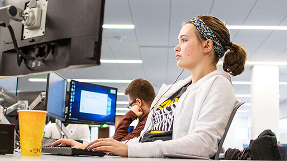 Computer Lab assistant working in the computer lab