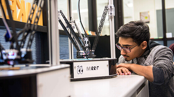 Student working on a project in the 3D lab, called the MAKERLab