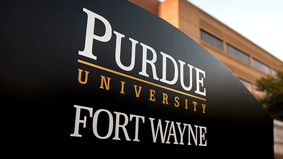 A sign with the Purdue University Fort Wayne logo on it.