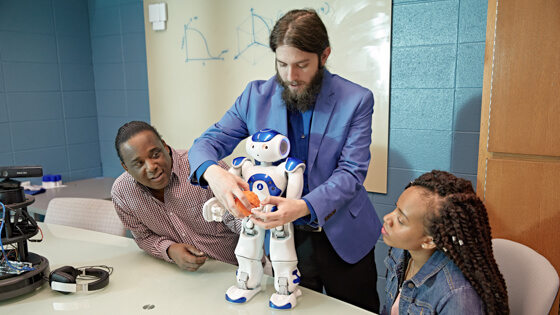Students learn about a robot.
