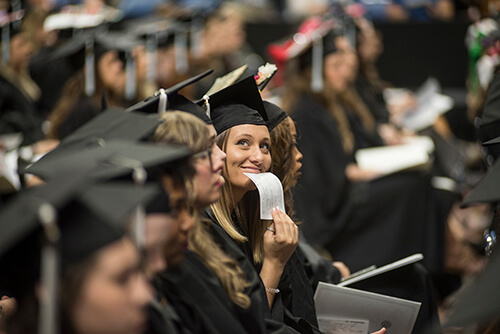 A graduate gazes out into the crowd during the commencement ceremony.